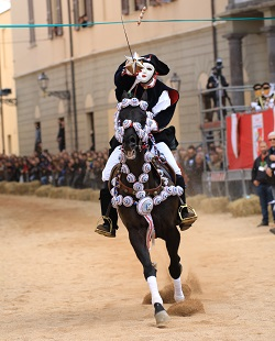 Rider piercing sartiglia with sword