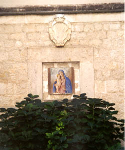 Madonna with child located on the exterior of the Abbey of Monte Cassino