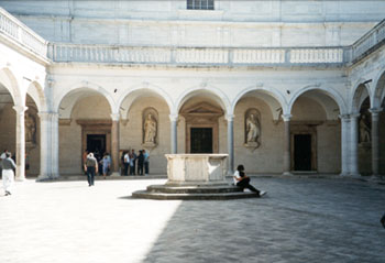 Cloister of the Benefactors & facade of the Basilica