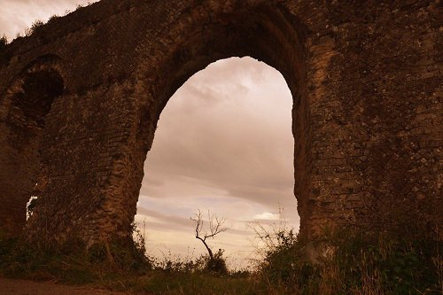 Peering Through the Arch of the Roman Aqueduct - Minturno Italy.