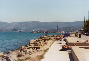 Sunbathing by the Adriatic sea in the town of Muggia